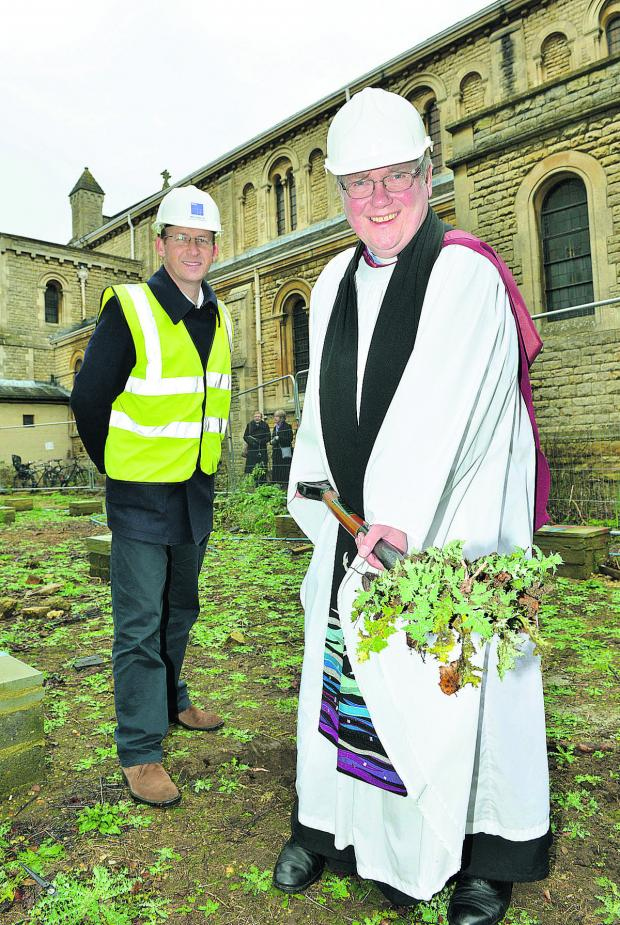 The Oxford Times: Charles Darby, director of MEB Designs, oversees The Very Rev Robert Key, digging the first turf at St Andrew's