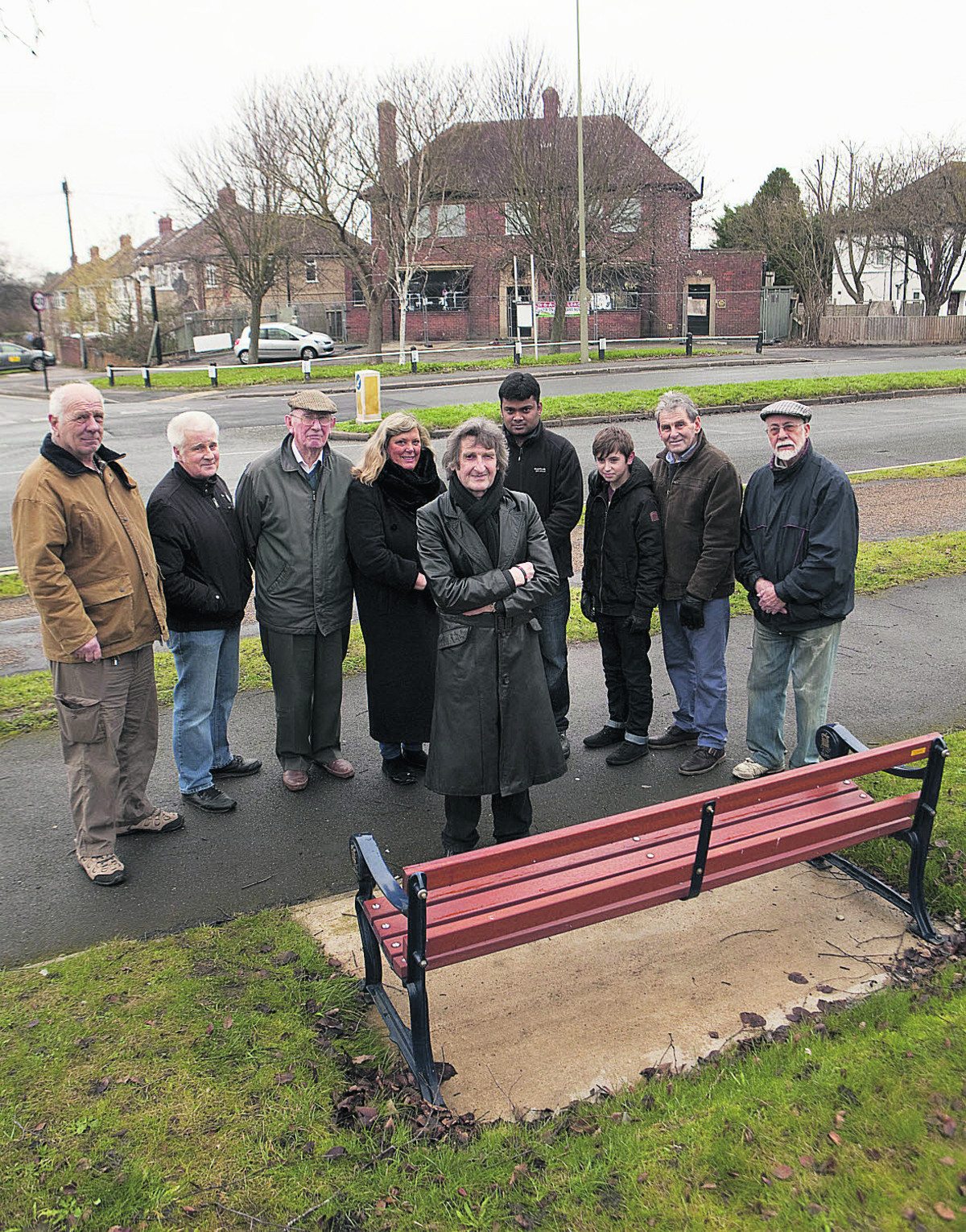 City councillor Mick Haines with local residents at the memorial bench