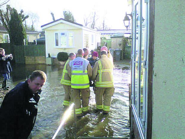 FLOODING: Trapped gran, 93, living high and dry