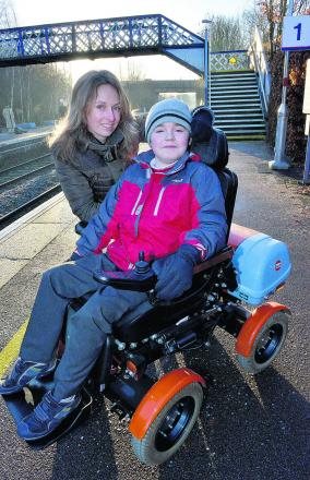 Angela Dickson and son John at Kingham Station, where plans for disabled access are under way