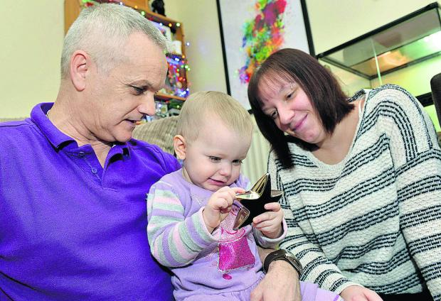Eoin and Charlene Davies with their 19-month-old daughter Avah. Picture: OX64635 Simon Williams