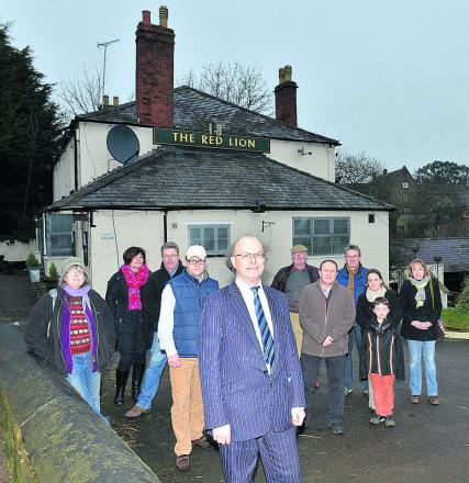 Roaring trade: Colin Challenger, with the other members of Bloxham Red Lion Steering Group, in front of the pub