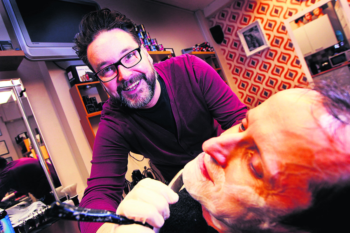 Gareth Clark gives Jon Driscoll a clean look as he prepares for the regional round of a national shaving contest