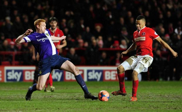 The Oxford Times: Dave KItson, pictured straining to reach the ball in Tuesday's 2-2 draw at Charlton Athletic in the third round of the FA Cup, thinks Oxford United would benefit from two new signings