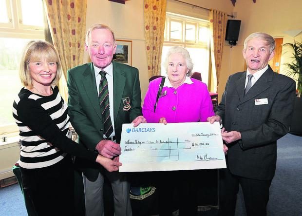The Oxford Times: From left, Frilford Heath Golf Club ladies' captain Sue Russell and men's captain Mike Chapman hand the cheque for the air ambulance to fundraisers, Janet and Ray Dawson.  Picture: OX64609 Damian Halliwell