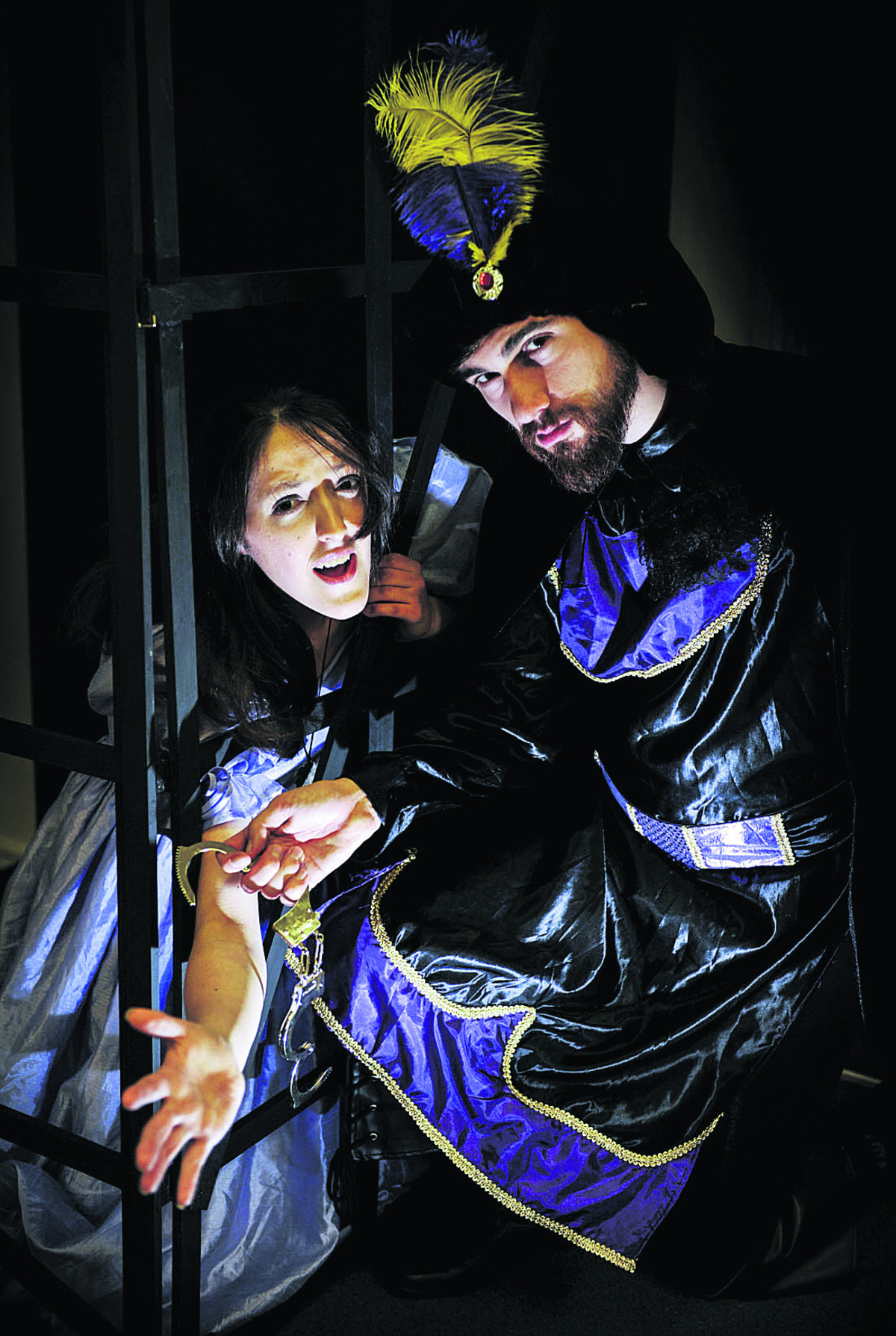 Richard Dreyer, as Evil Lord Roger, locks up Princess Alice, played by Emily Hemming in the Witney Methodist Church panto, Puss in Boots