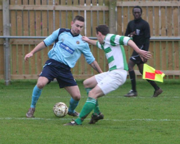 Ardley United's Ryan Brooks attempts to beat Wantage's Tom Butler
