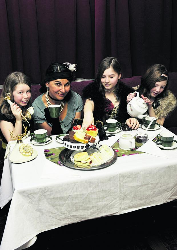 The Oxford Times: TEA DANCE: From left, Libby Haddield, 10, Lilia Bonacorsi, Freya Goozee, 12, and Helen Woods, 12, celebrate