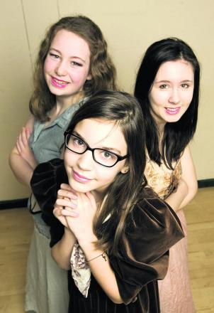 Ellie Tullis-Hughes stars as Belle, centre, alongside Hannah Wilson and Anna Muddiman as village girls