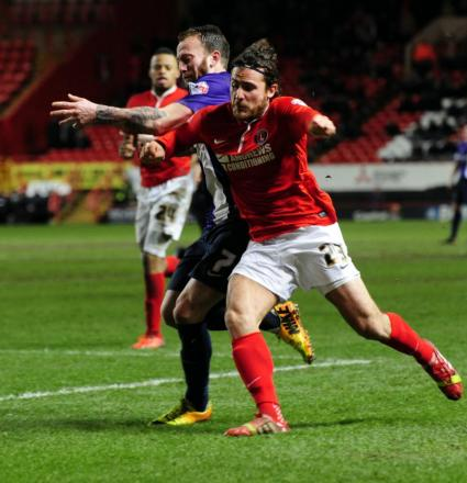 United's Sean Rigg (left) and Charlton's Lawrie Wilson battle it out in the 2-2 draw at The Valley. The U's bid for a place in round four in tonight's replay