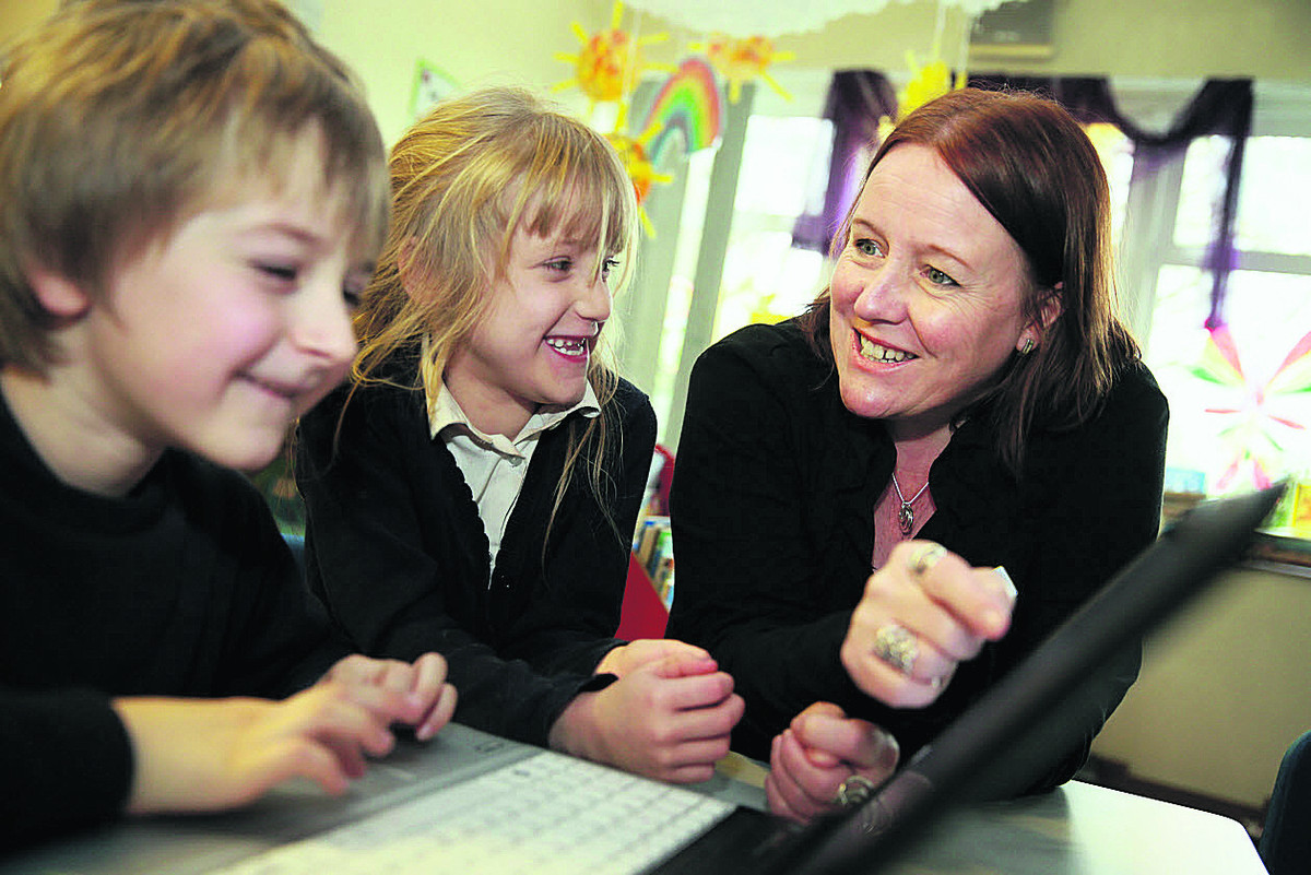 Headteacher of Tower Hill School in Witney, Tracey Smith, speaks with pupils Camron Edwards, seven, and Charlie Green, seven. Picture: OX64751 Damian Halliwell