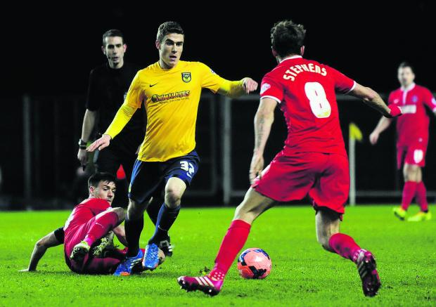 The Oxford Times: Josh Ruffels taking on Charlton Athletic in the FA Cup  Picture: David Fleming Order no: OX64682