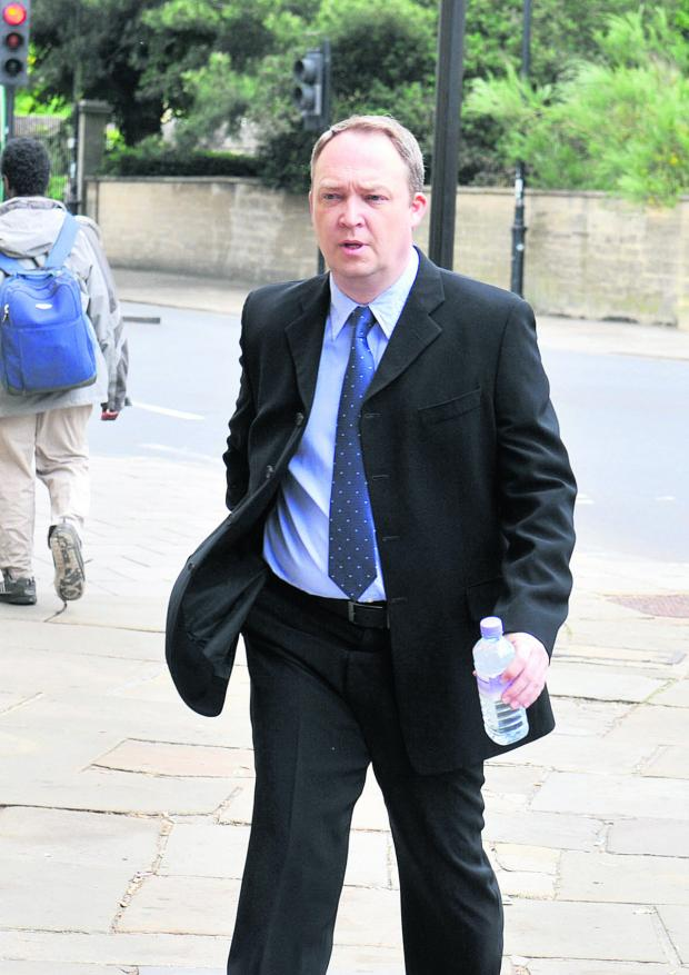The Oxford Times: Fraudster Andrew Griffin pictured outside Oxford Crown Court in June last year