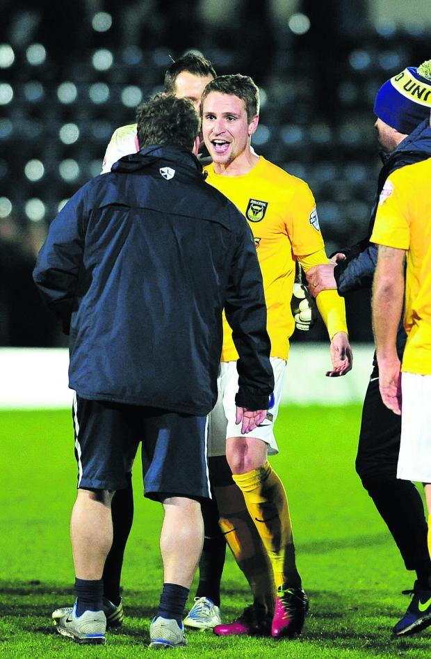 The Oxford Times: Goal hero Nicky Wroe is all smiles with Mickey Lewis after Oxford United's win at Wycombe
