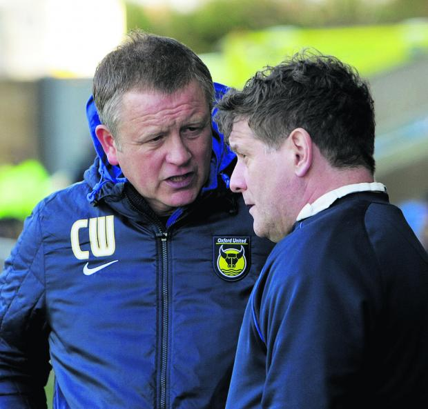 Chris Wilder deep in conversation with No 2 Mickey Lewis at a recent Oxford United home match