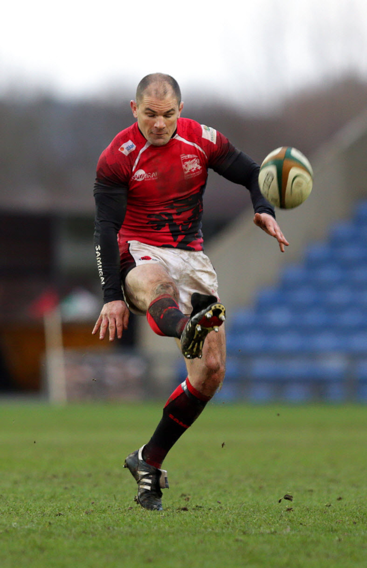 London Welsh's Gordon Ross boots the ball forward