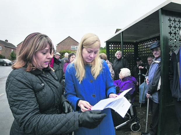 Resident Nikki Cavanagh hands a petition to Nicola Blackwood about the 4C