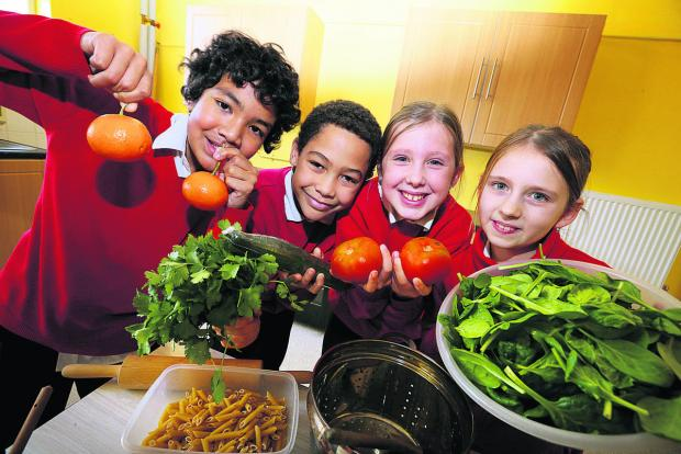 Rose Hill Primary School pupils, from left, Nanio Carvalho, 11, Ryan Ribeiro, 10, Chloe Palmer, 10, and Ieva Vilkauskaite, 11 who are looking forward to cookery lessons