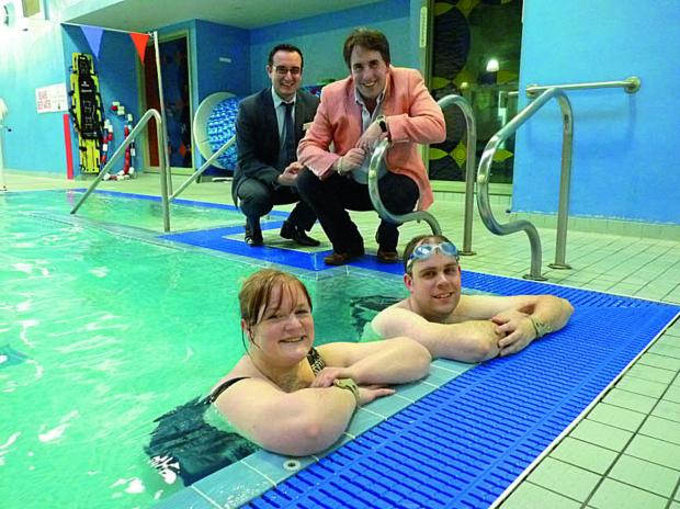 Rob Wood, GLL Partnership Manager, left, and Cllr Richard Langridge, with swimmers Sharon Brewer, 30, left, and Alastair Blaine, 34