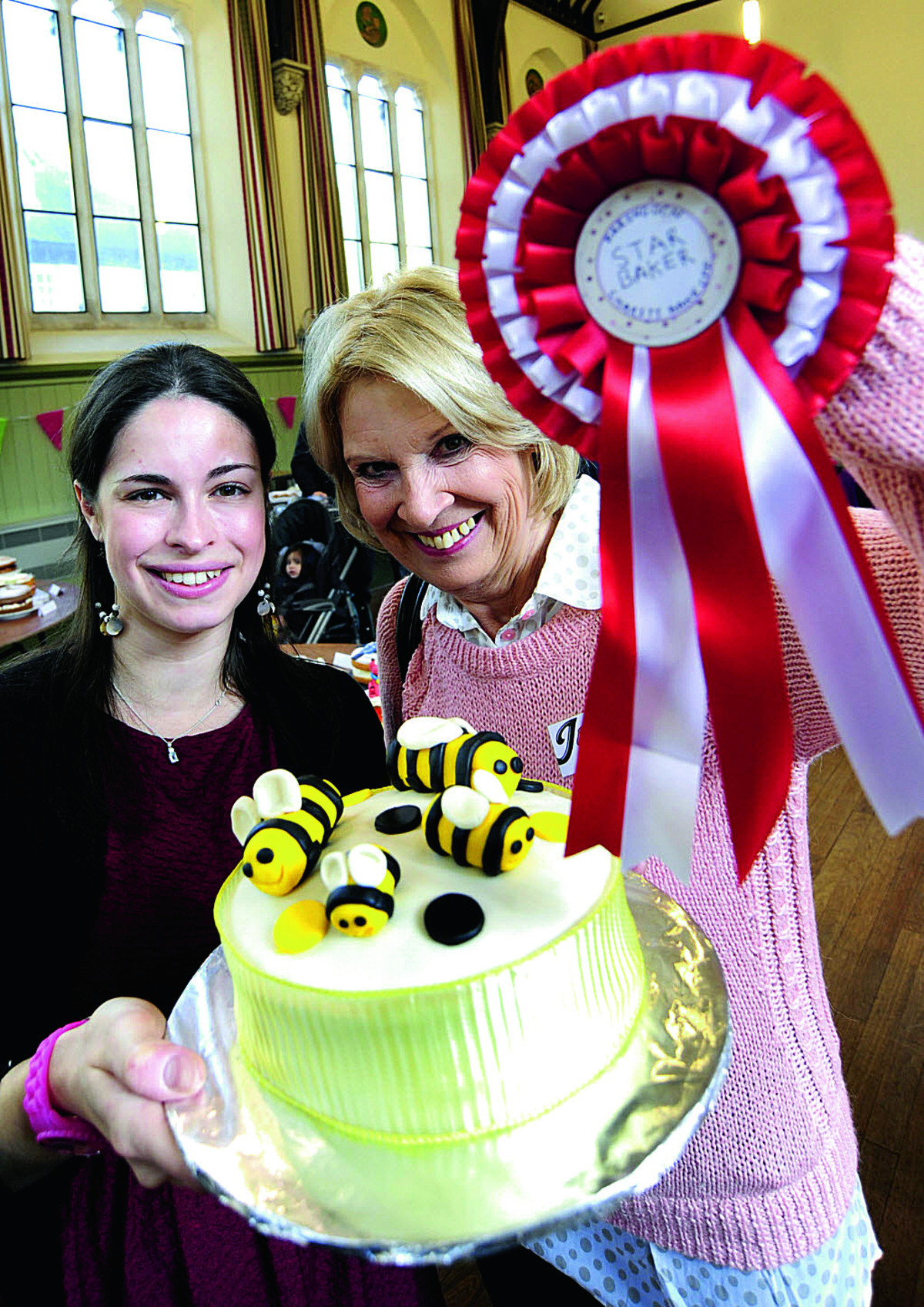 Charity Bake Off organiser Emma Oyston, left, and Great British Bake Off contestant Christine Wallace with one of the cakes       Picture OX64844: David Fleming