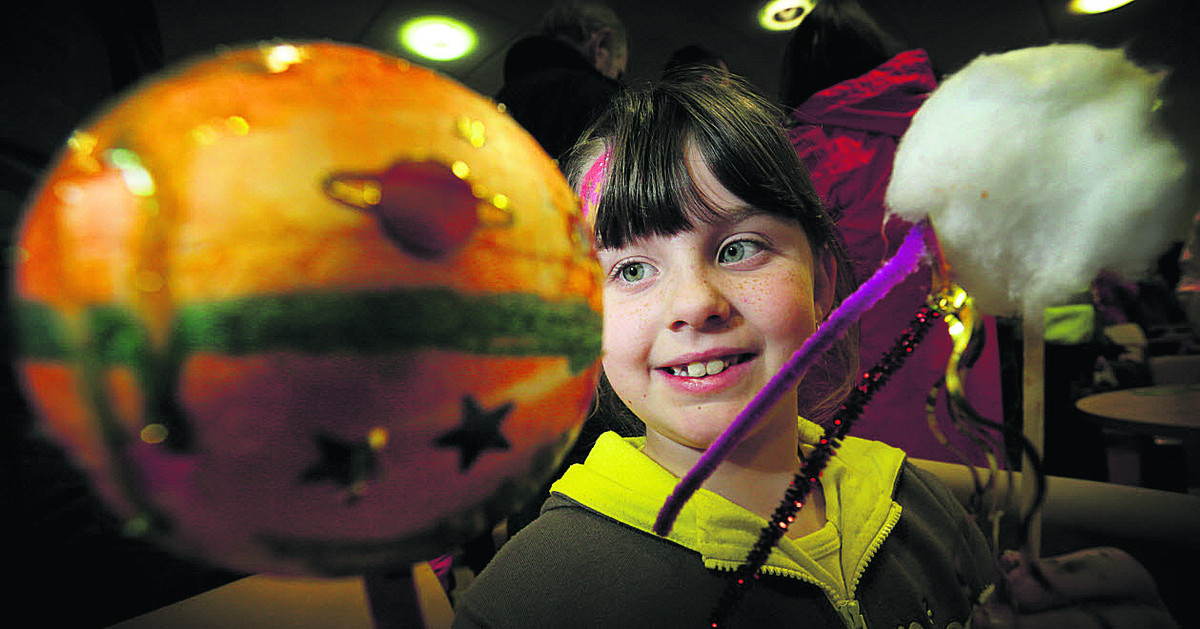 Seven-year-old Laura Miles from Didcot with a planet and a comet that she made