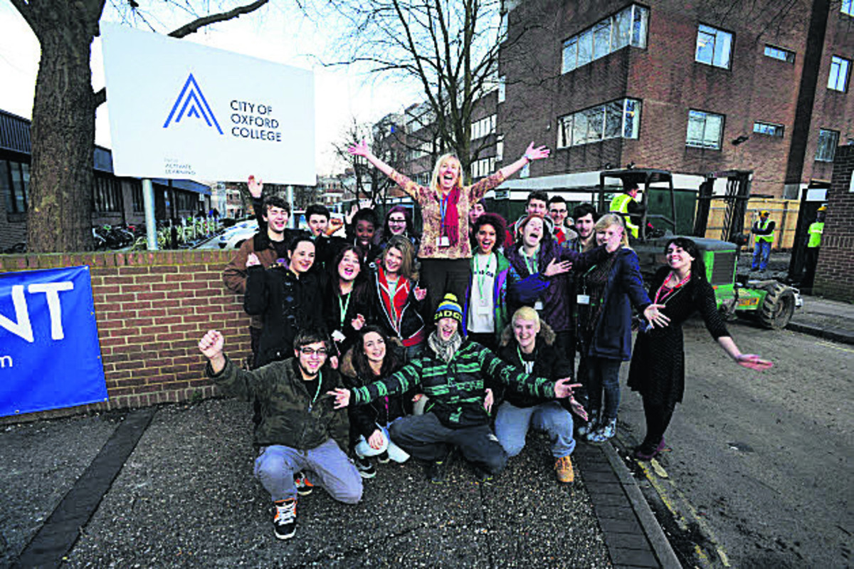 City of Oxford College students join teacher Sam Wise, centre, to celebrate the Ofsted rating            Picture: OX64886 Jon Lewis