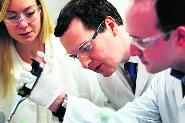 The Oxford Times: Chancellor George Osborne, centre, at Begbroke Science Park with Nicola Blackwood MP and Dr Simon Hughes, senior scientist                 Picture: OX64927 Ed Nix
