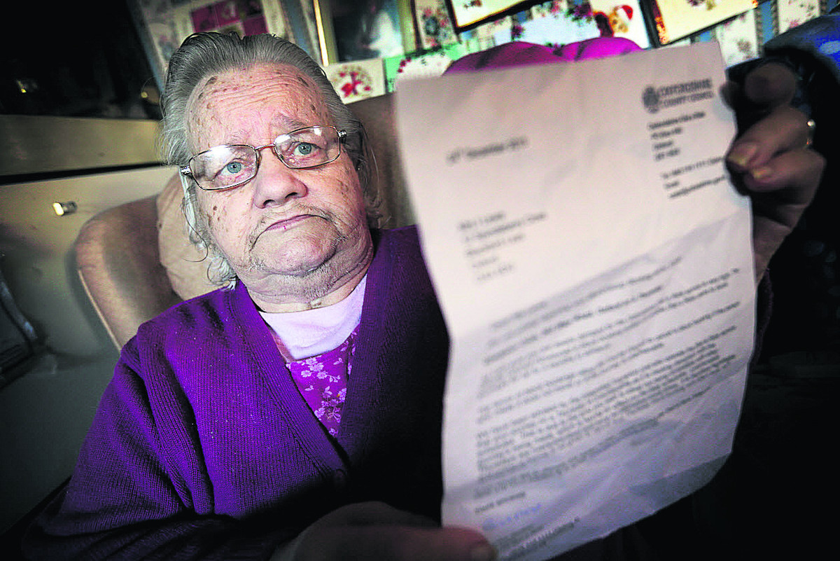 Iris Lewis with her cancellation letter from Dial-a-Ride. Picture: OX64409 Damian Halliwell
