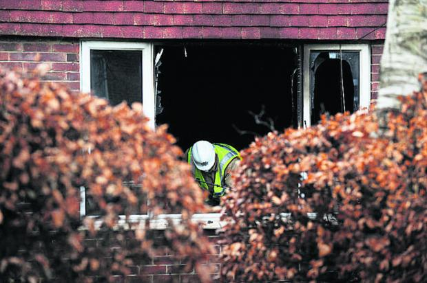 The Oxford Times: A fire investigator at the scene