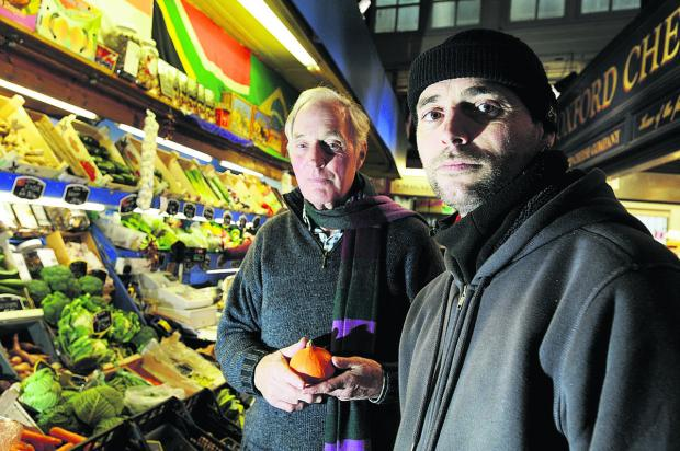 City councillor Jim Campbell, left, who led the Covered Market review, and Gordon Piggott, of McCarthy's fruit and veg stall.  Picture: OX64959 Jon Lewis