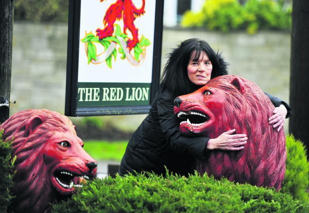 The Oxford Times: Landlady Chrissie Jones is selling the two red lions from her Yarnton pub. Picture: OX64992 Mark Hemsworth