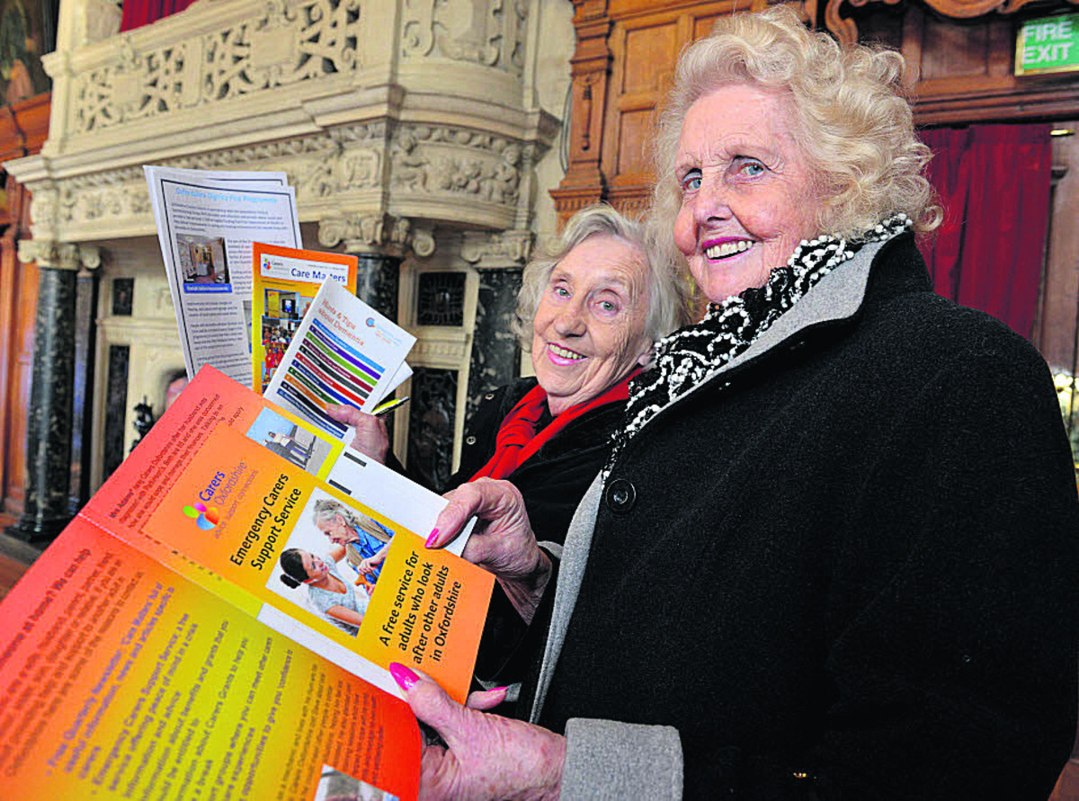 Audrey Dodshon, left, and Jo Elkins look through literature at the Dignity event. Picture: OX65007 Simon Williams