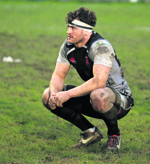 The Oxford Times: London Welsh back row forward Mike Denbee shows his disappointment after their shock defeat away to Plymouth  Albion.  Picture: Martin John