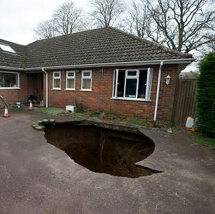 The Oxford Times: The home of Phil and Liz Conran, High Wycombe, after a 30ft-deep sinkhole opened up in the driveway and swallowed their car