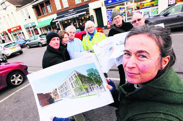 The Rev Clare Sykes, front, with, rear from left, John Gill, Mary Gill, Gordon Stokes, Ag MacKeith, Grant Nightingale and the Rev Graham Sykes with some West Way plans; below, an artist's impression