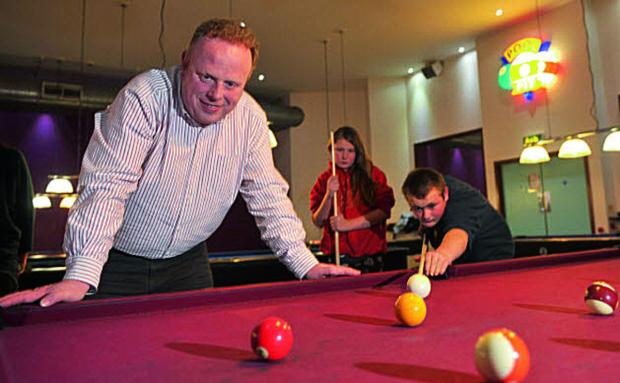 Richard Colbrook, project leader, watches Charley, left, and Leo play pool. Picture OX64945: Denis Kennedy