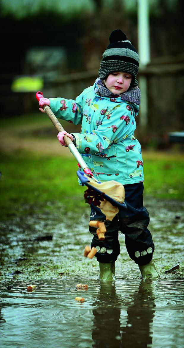 The Oxford Times: Louis Denno, three, fishes for corks at the Nature Tots day  Picture OX64967 Damian Halliwell
