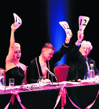Judges Jade Main, David Roberts, centre, and Bill Heine cast their votes.  Pictures: OX64817 Ed Nix