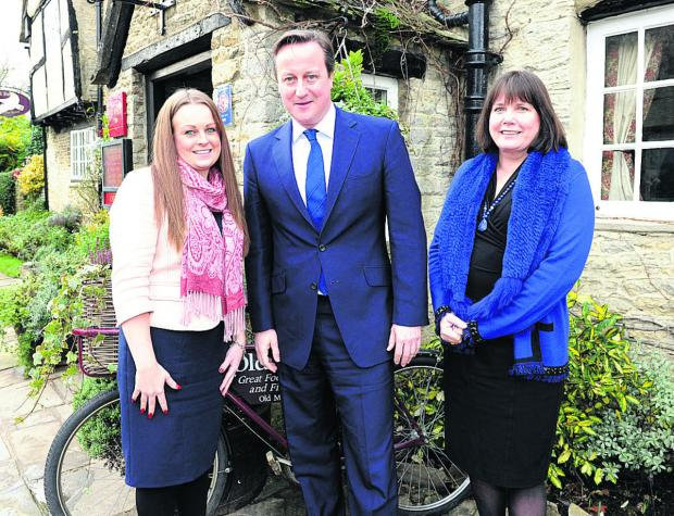 Vicky Steedman, David Cameron and Lana de Savary at the hotel. Picture: Edward Lloyd/Alpha Press