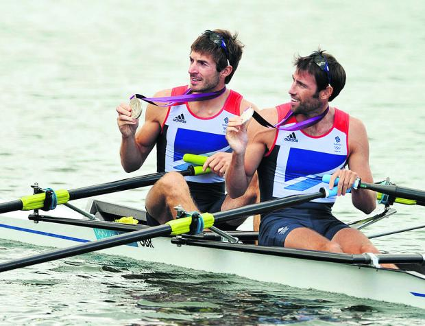 Zac Purchase (left) and Mark Hunter show off their silver medals at the London Olympics