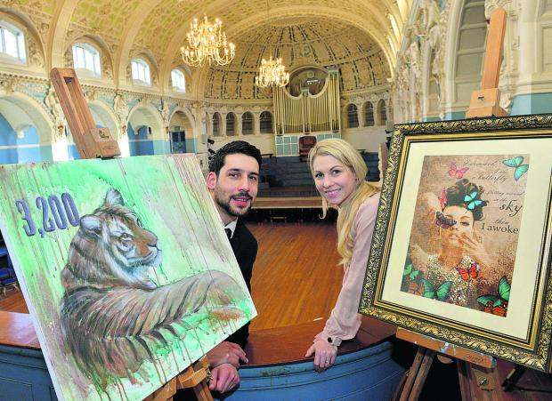 Oxford artists Gareth Lloyd, with his painting of an endangered tiger, and Joelle Dinnage, with a painting by Pia Vang entitled Butterflies, on loan from the Funky Art Gallery in Oxford. Picture: OX65011 Simon Williams