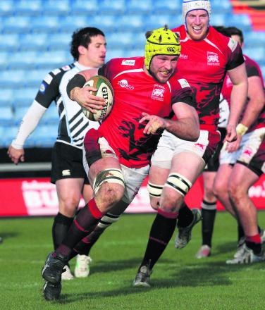 London Welsh No 8 Richard Thorpe breaks into a big smile as he races behind the posts for their