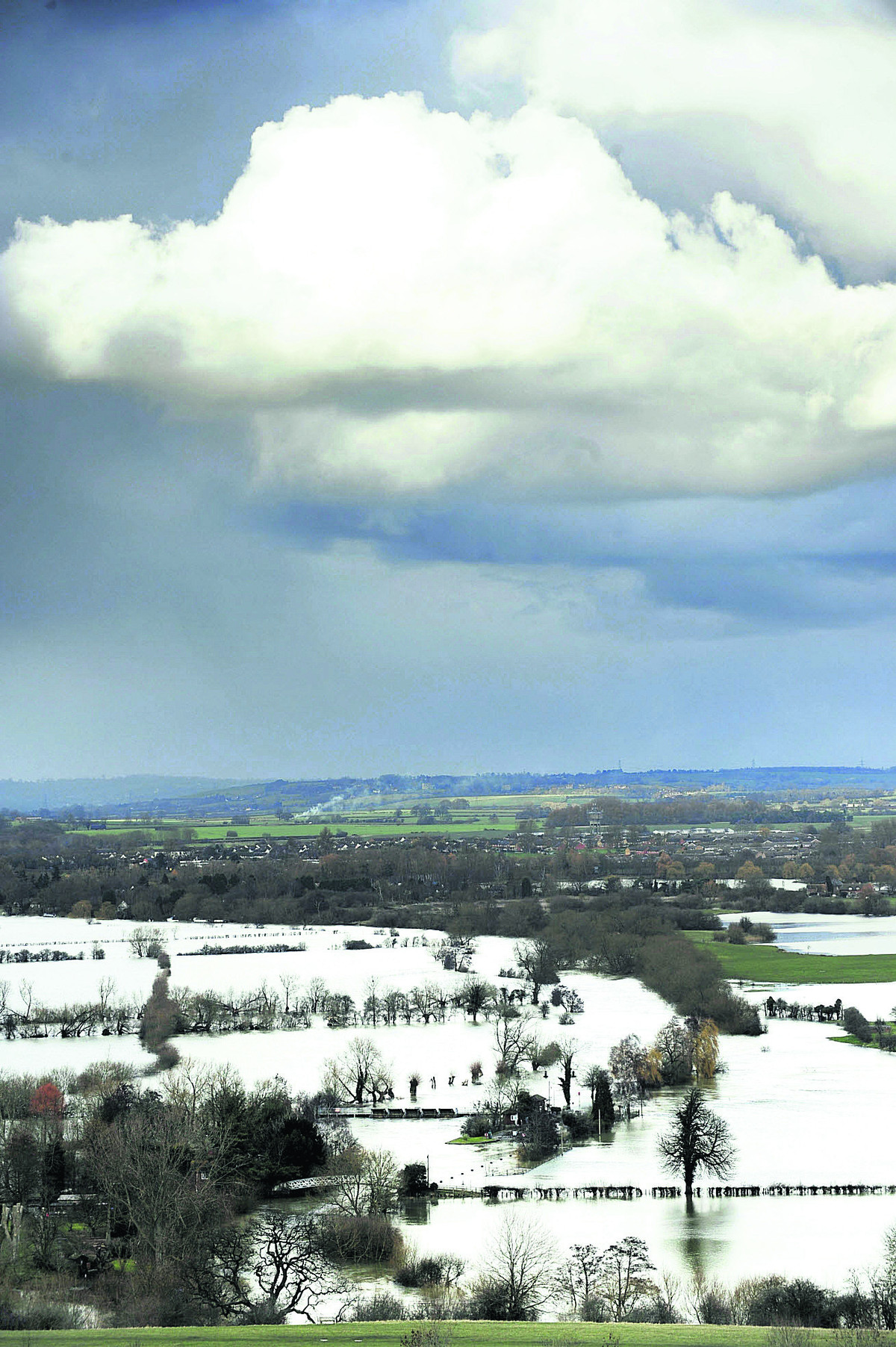 Views from Wittenham Clumps yesterday show flooded fields and footpaths, stretching from Little Wittenham and Day's Lock up towards Dorchester. Picture: OX65235 David Fleming
