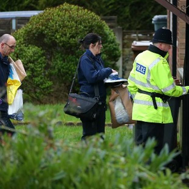 The Oxford Times: Police forensic officers arrive at a house in Emily Street, Blackburn, after a baby girl died when she was mauled by a pet dog
