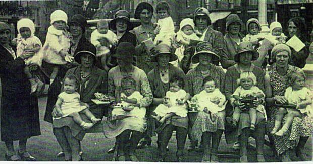 Besse with baby Maurice is back row, fourth from the left, Mrs Coles, back row far right, Mrs Blowfield, front row first left, Mrs Bannister front row far right