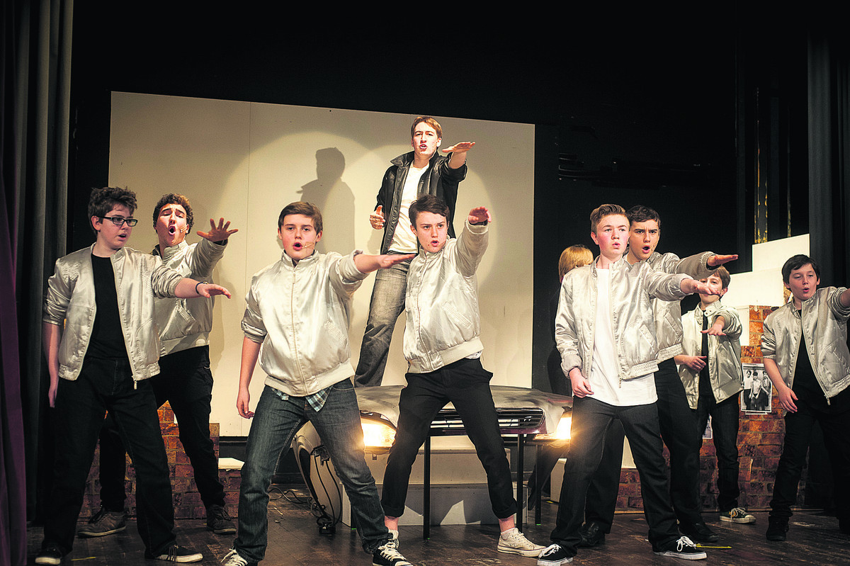 Alex Lushington, in the black jacket, as Kenickie with the T-Birds in Larkmead School's production of Grease  Picture: OX65148 Andrew Walmsley