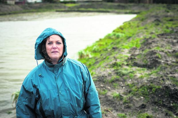Zoe Patrick at the flooded field in Grove 	Picture: OX65273 Andrew Walmsley
