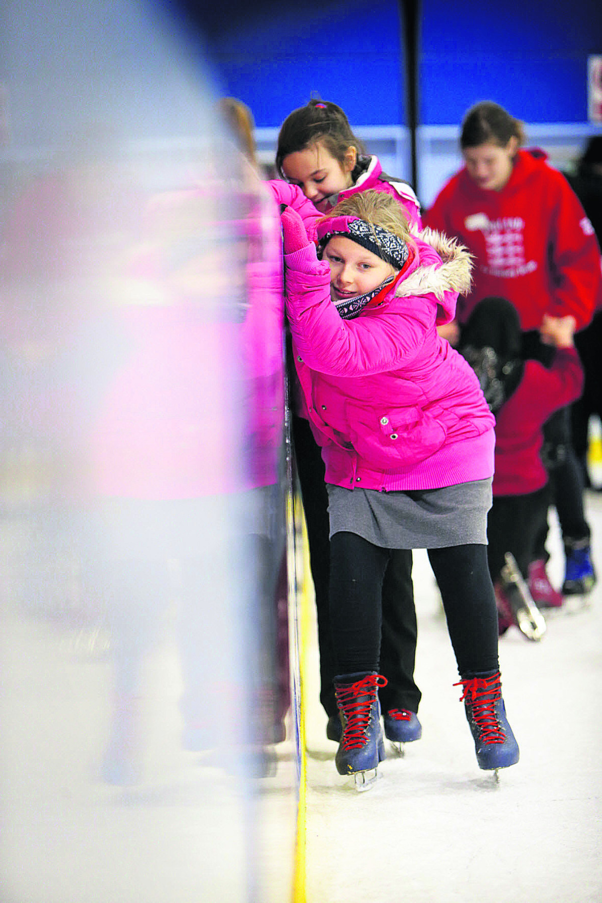 Anna Ward, from Rose Hill Primary School, hangs on tight as she negotiates the ice at the Oxpens rink