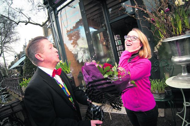 The Oxford Times: Tenor singer Mike Woodward from Opera Anywhere hooked up with florists Fabulous Flowers in Banbury Road, Oxford, to offer a 'opera-o-gram' service to romantic Valentine's. Here he delivers a bouquet to Olivia Hay while serenading her