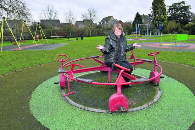 The Oxford Times: Environment committee chairman Lynn Pratt in the dated play area at Garth Park       Picture: OX65252 Simon Williams